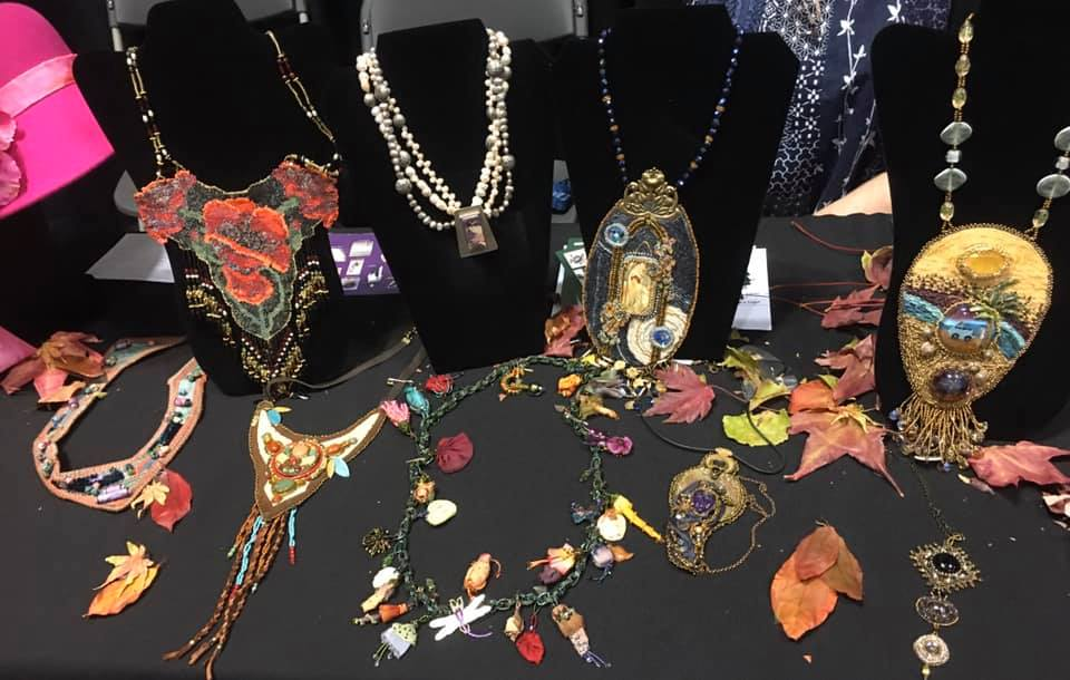 A collection of wearable pieces made by PenWAG members