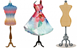 image of 3 dress forms, one with a painted dress