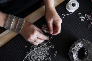 Tonje Halvorsen's hands crafting with safety pins